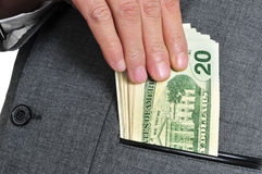 Dollar bills in the pocket Royalty Free Stock Images