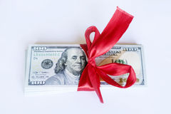 100 dollar bills with red ribbon on a white background Royalty Free Stock Photos
