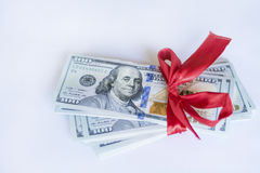 100 dollar bills with red ribbon on a white background Stock Photo