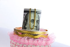 Dollar bills roll money with gold Royalty Free Stock Image