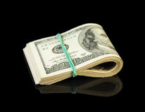 Dollar bills rolled up Royalty Free Stock Image