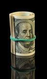 Dollar bills rolled up Stock Photography