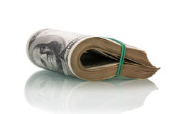 Dollar bills rolled up Stock Photo