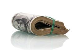 Dollar bills rolled up Stock Photo