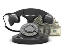 Dollar bills and rotary phone Stock Photography