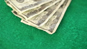 Dollar bills spinning. On a gambling table stock video