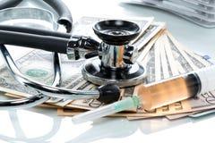 Dollar bills with stethoscope Stock Photo