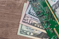 Dollar bills from technology. green motherboard. Close up Stock Photography
