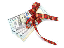 Dollar bills tied with red ribbon and decorated as a gift on a w. Hite background Stock Photos