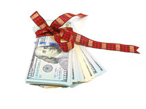 Dollar bills tied with red ribbon and decorated as a gift on a w. Hite background Stock Photography