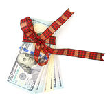 Dollar bills tied with red ribbon and decorated as a gift on a w. Hite background Stock Photo
