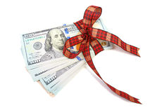 Dollar bills tied with red ribbon and decorated as a gift on a w. Hite background Stock Images