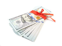 Dollar bills tied with red ribbon and decorated as a gift on a w. Hite background Stock Image