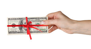 dollar bills tied red ribbon in hand Stock Images