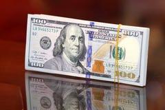 Dollar bills. Usd american dollar bills on glass background Royalty Free Stock Images