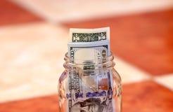 Dollar bills. Usd american dollar bills in glass box Royalty Free Stock Photo