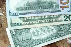 Dollar bills. Usd american dollar bills on rustic wooden background Stock Images