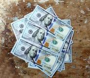 Dollar bills. Usd american dollar bills on rustic wooden background Stock Photography