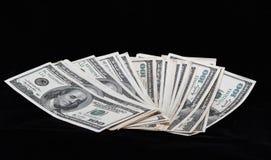 Dollar on a black Stock Image