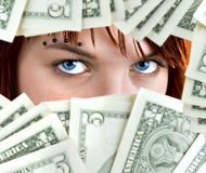 Dollar blue eyes Royalty Free Stock Image