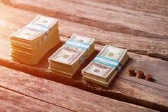 Dollar bundles near coins. Stock Photography
