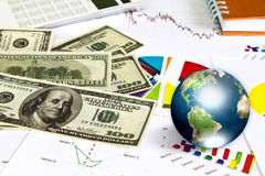 Dollar and business graph with earth. Stock Photos