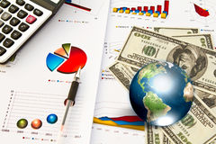 Dollar and business graph with earth. Royalty Free Stock Image