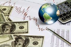 Dollar and business graph with earth. Stock Photo