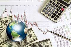 Dollar and business graph with earth. Stock Image