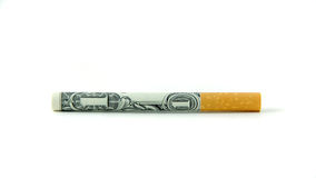A Dollar a Butt. A single cigarette made from a dollar bill Stock Photo
