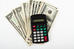 Dollar and calculator Stock Photography