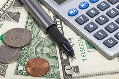 Dollar and calculator Royalty Free Stock Images