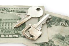 Dollar cash. Two keys on dollars isolated on white background Stock Image