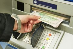 Free Dollar Cash Withdrawal From ATM Stock Images - 107525284