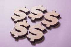 The dollar casts a shadow on the table stock photography