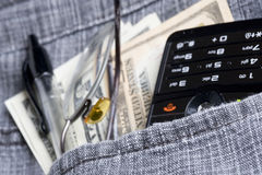 Dollar and cell phone Stock Photo