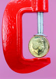 Dollar Clamp Down Stock Photography