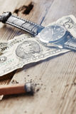 Dollar, clock and cigar Royalty Free Stock Photography
