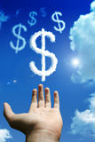 Dollar clouds Stock Image