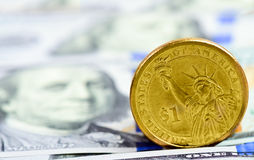 Dollar coin on the American banknotes Stock Images