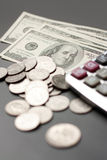 Dollar, coin and calculator Stock Photography