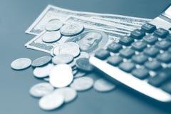 Dollar coin and a calculator. Selective focus. monochrome Royalty Free Stock Photos