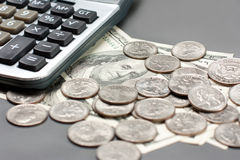 Dollar coin and calculator Stock Images