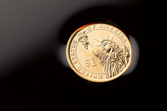 Dollar coin in the crude oil Royalty Free Stock Image