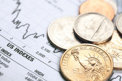Dollar coin and financial graph Royalty Free Stock Photo