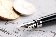 Dollar coin and financial graph Stock Photography