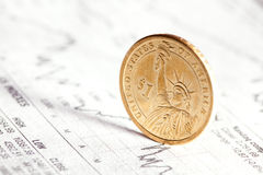 Dollar coin and financial graph Stock Photo