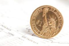 Dollar coin and financial graph Stock Photos