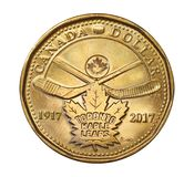 Dollar coin to commemorate the 100th anniversary of the Toronto Maple Leafs hockey team. The Canadian mint issued this special dollar coin to commemorate the stock photography