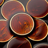 Dollar coins in the crude oil Royalty Free Stock Images